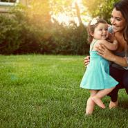 Mother and daughter playing outside in mosquito-free yard